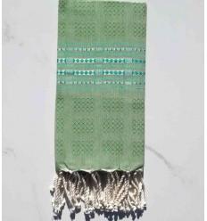 toalla de spa verde medio con patrones