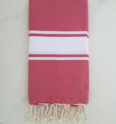 Toalla de playa rosa tejido plato